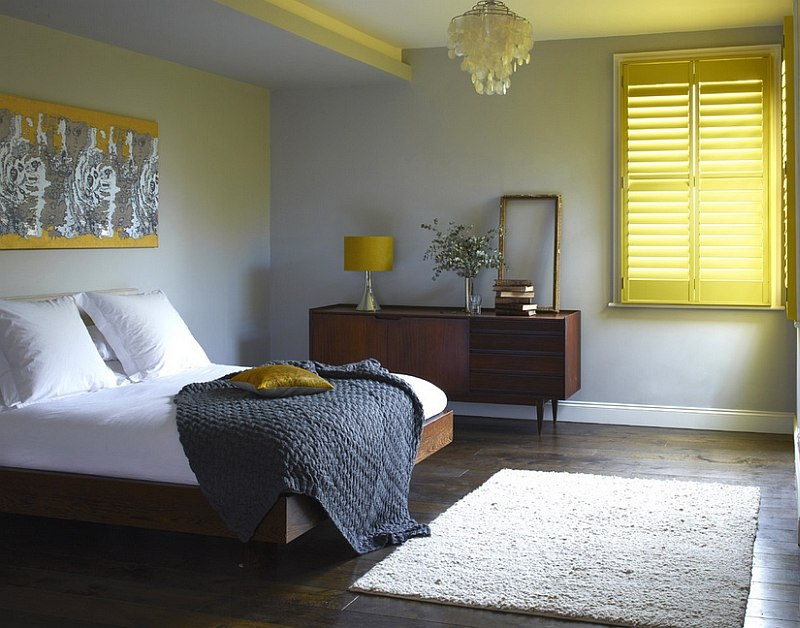 Shutters add cheerful yellow glow to the bedroom [Design: Weatherwell Elite - Aluminum Shutters]