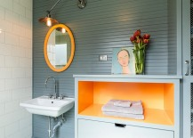 Simple orange additions can infuse energy into the dull bathroom