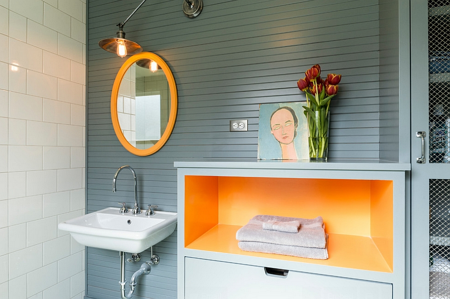 Simple orange additions can infuse energy into the dull bathroom [Design: J.A.S. Design-Build]