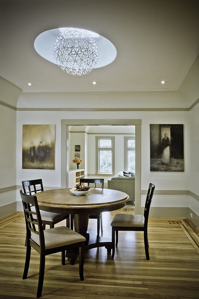 Skylight used along with pendant to light up the traditional dining room [Design: Andre Rothblatt Architecture]