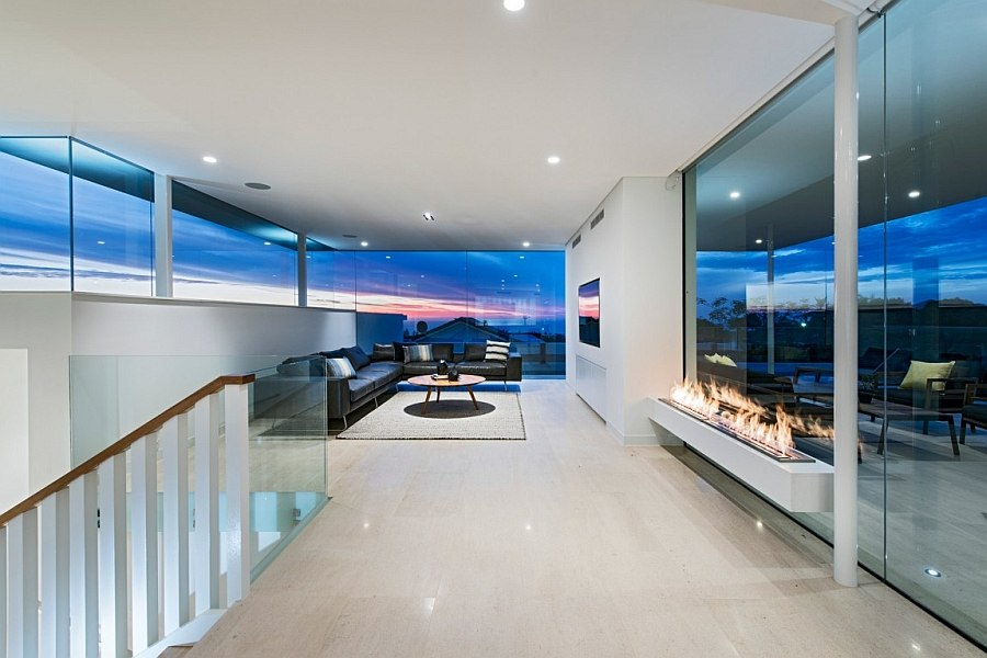 Sleek fireplace blends in with the minimalist style of the home