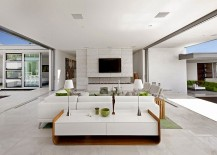 Sliding-glass-doors-blur-the-lines-between-the-interior-and-outdoors-217x155