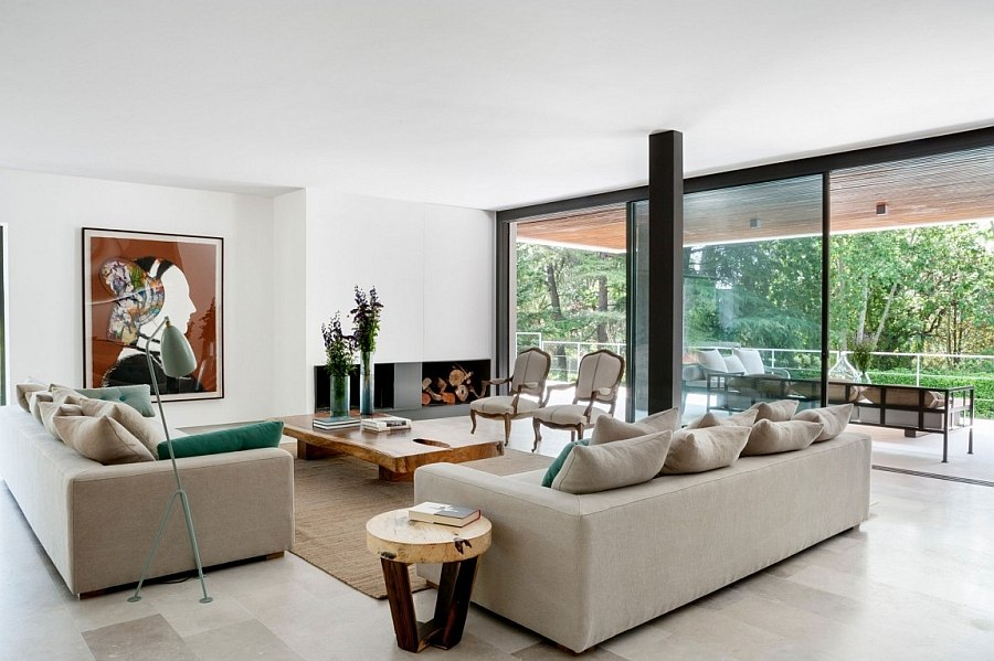 Sliding glass doors connect the living area with the balcony