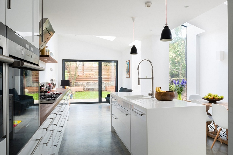 Slidinig glass doors connect the kitchen with the backyard