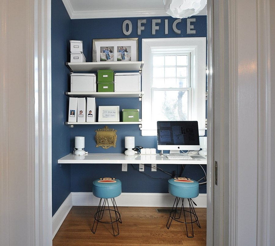 Small home office design with sleek shelves in white and a blue backdrop [Design: Anthony James Construction]