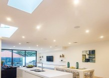 Smart ceiling design brings natural light to the lower level of the home