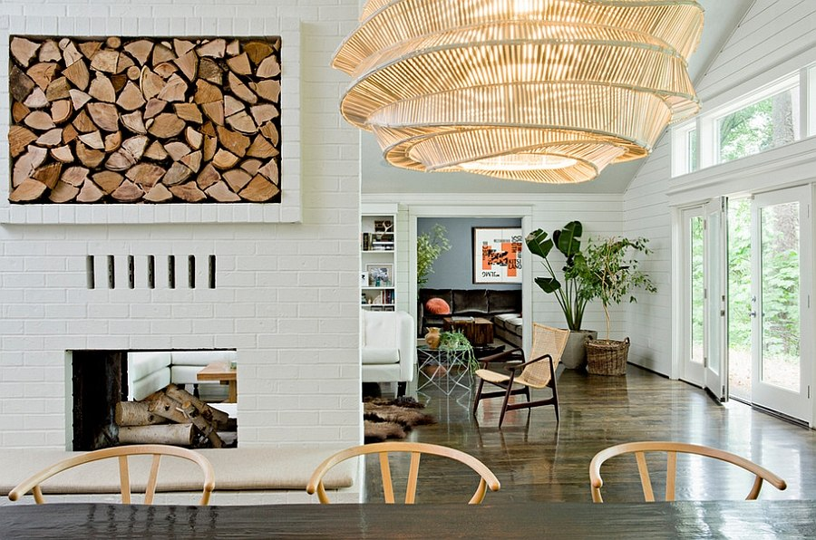 Smart firewood storage space becomes an artistic addition in this dining room [Design: Jessica Helgerson Interior Design]