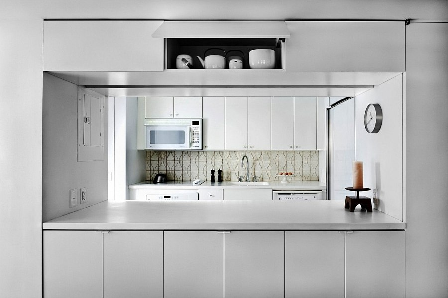 Smart kitchen shelves give the space a sleek, organized appeal