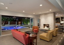 Stackable glass doors connect the living room with the pool