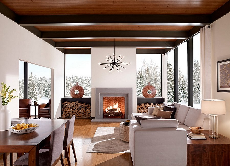 Stacked firewood flanks the fireplace and adds elegance to the room [Design: Eldorado Stone]