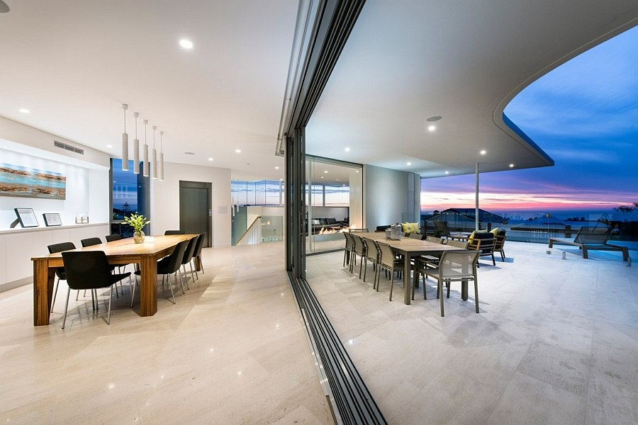Stacked sliding glass doors take the living area outside!