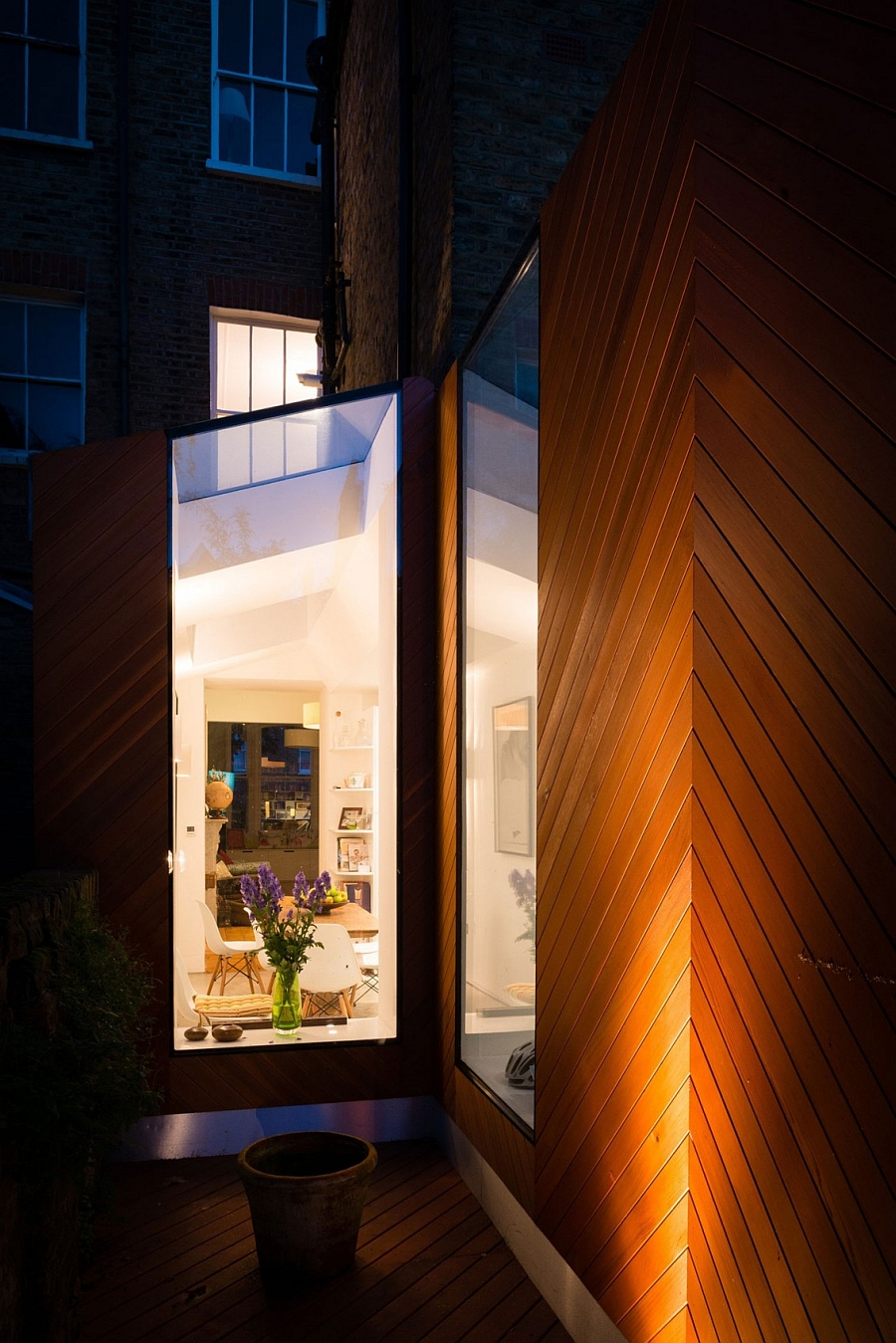 Stained cedar chevrons shape the exterior of the new addition