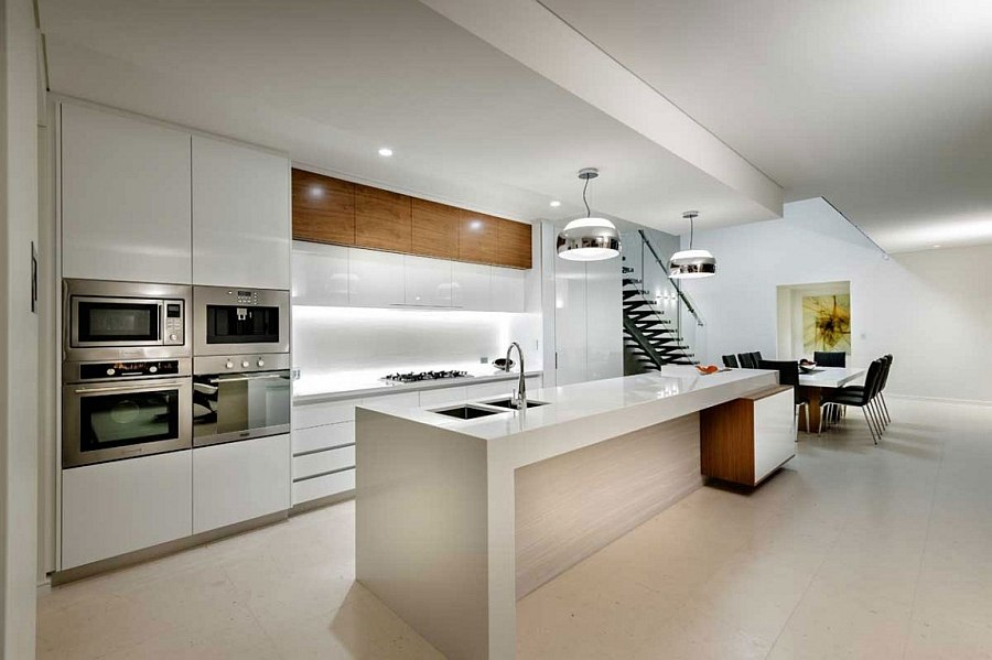 State-of-the-art kitchen in white with beautiful lighting