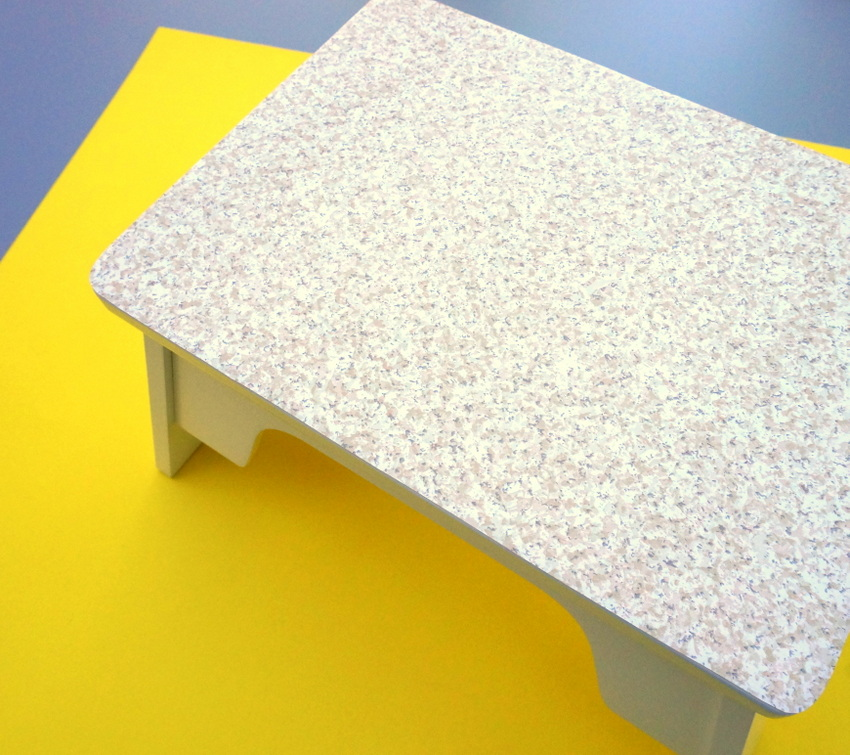Stepping stool with contact paper top