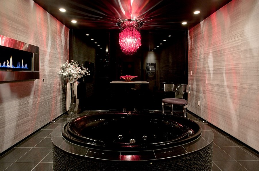 Stunning master bathroom with a sleek fireplace and brilliant lighting