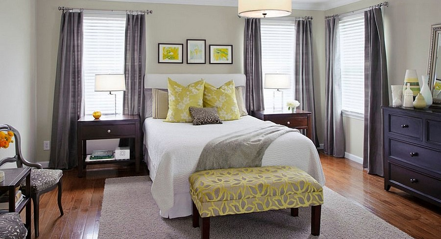 Stylish bench at the foot of the bed in yellow [Design: Tamsin Design Group]