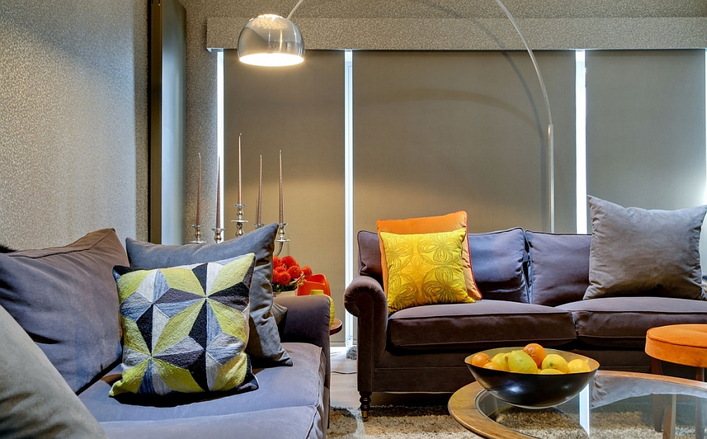 Stylish floor lamp and bright throw pillows enliven the cinema room