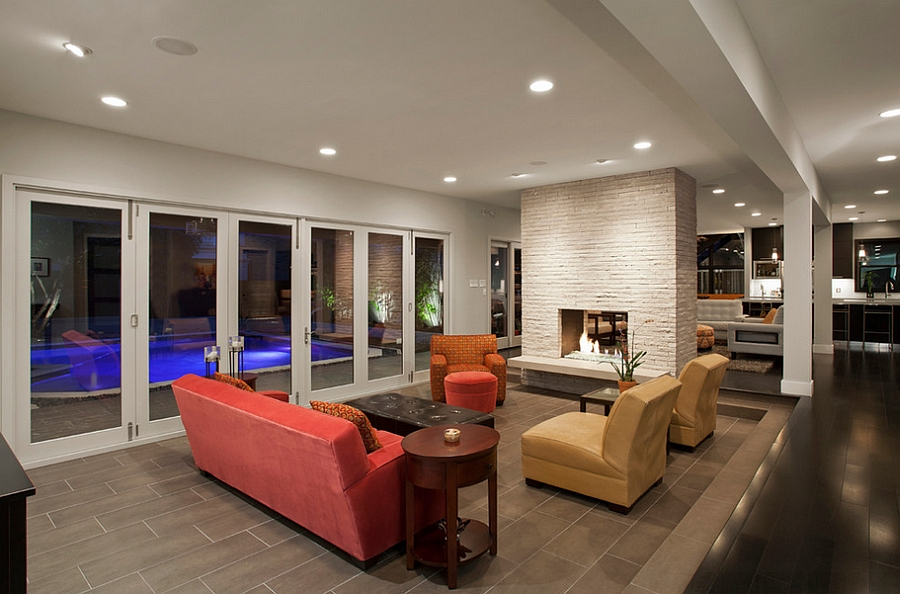 Sunken living room connected with the pool outside