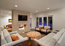 TV above the fireplace give the room a flexible dynamic
