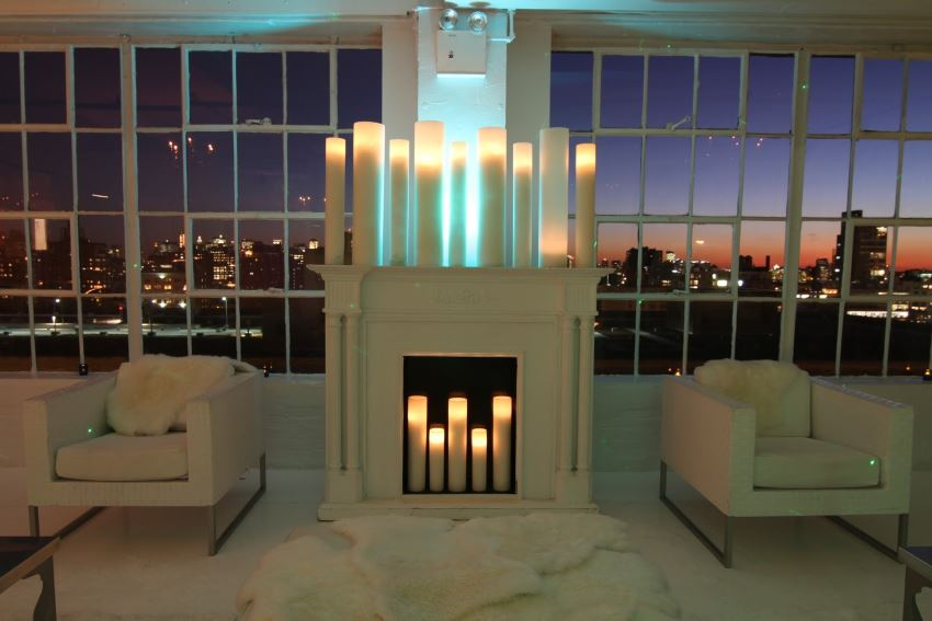 Tall candles in a winter loft venue