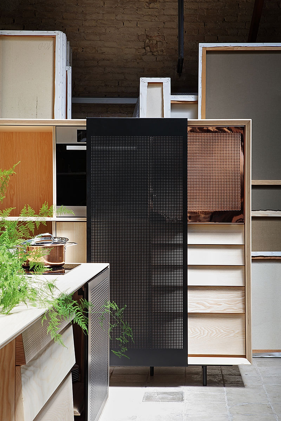 Tall wooden cabinet with sliding metal mesh door for the kitchen