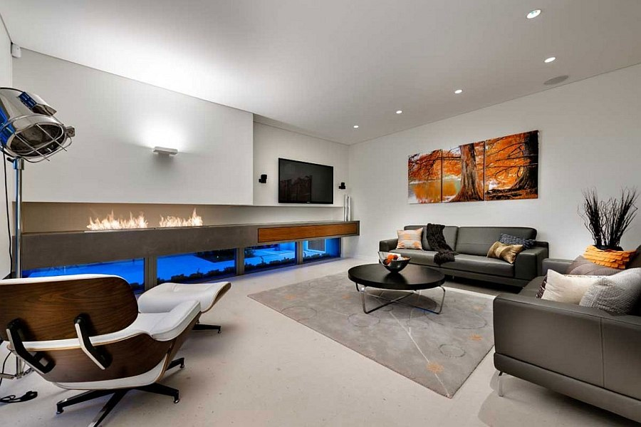 Trendy contemporary living room with a sleek fireplace