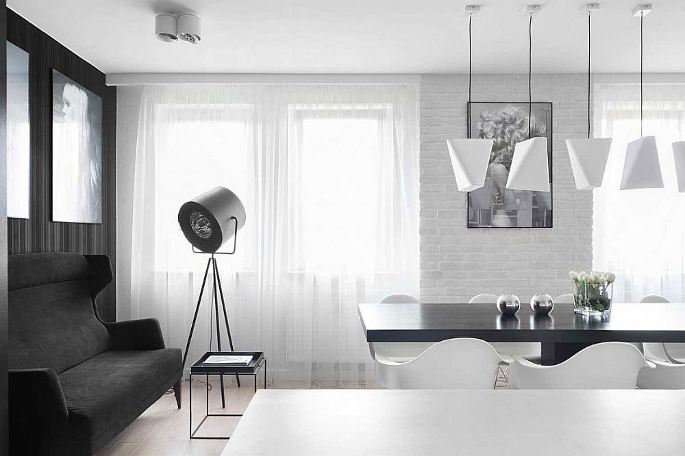 Tripod floor lamp gives the apartment a stylish, trendy appeal