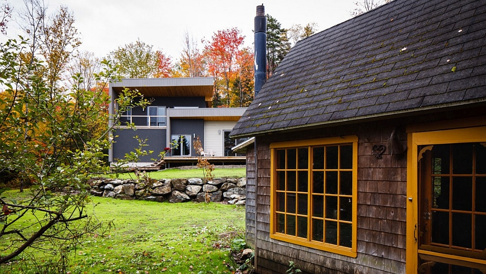 Twin structures and an old stone wall give the home rustic charm