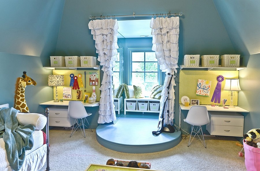 Twin workstations flank the simple performance stage in the kids' room! [Design: Organized Living]