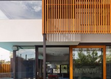 Vertical-wooden-slats-offer-privacy-even-while-allowing-sunlight-to-filter-through-217x155