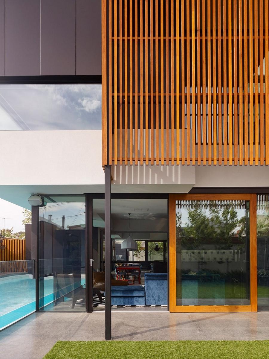 Vertical wooden slats offer privacy even while allowing sunlight to filter through