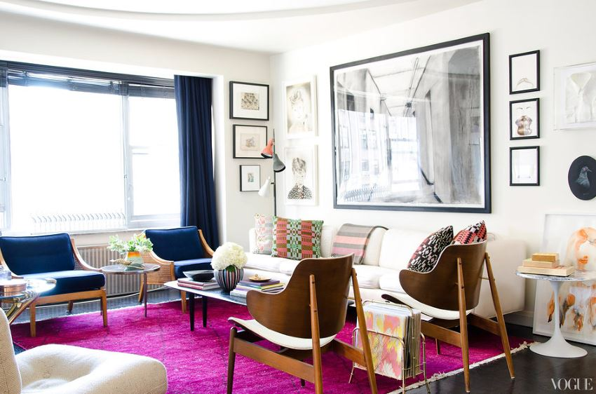 Vibrant purple rug in the apartment of Kyle DeWoody via Vogue