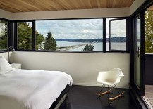 View of the lake in the distance from the cozy, modern bedroom