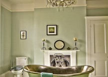 Vintage bathroom in green with a standalone bathtub