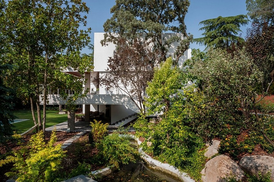 Walkways and outdoor landscape give the home a serene, natural appeal