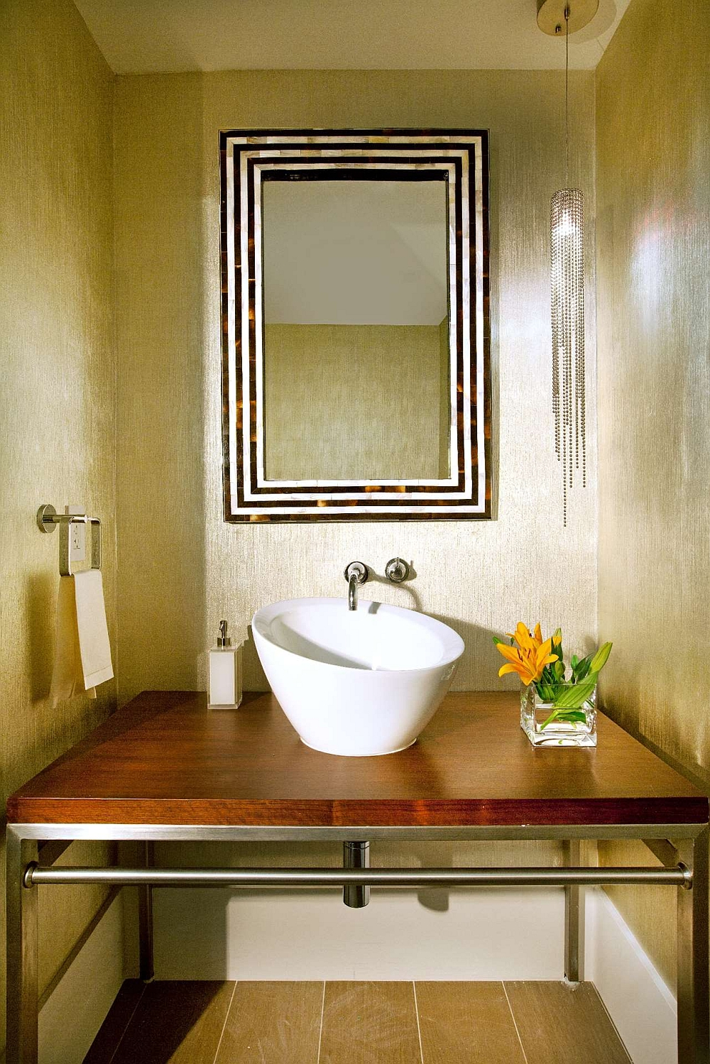 Wallcovering brings golden glint and texture to the powder room