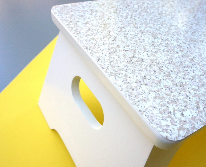 White step stool with a patterned top-001