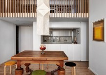 Wood slats allow for lovely flow of natural light across the two levels