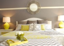 Yellow bedside lamps bring symmetry to the room