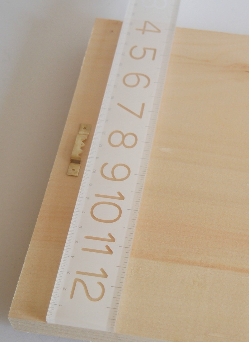 Measure the center of the board to hang it in style