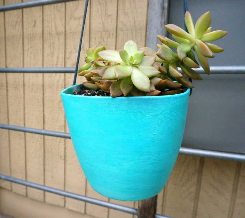 An aqua hanging planter