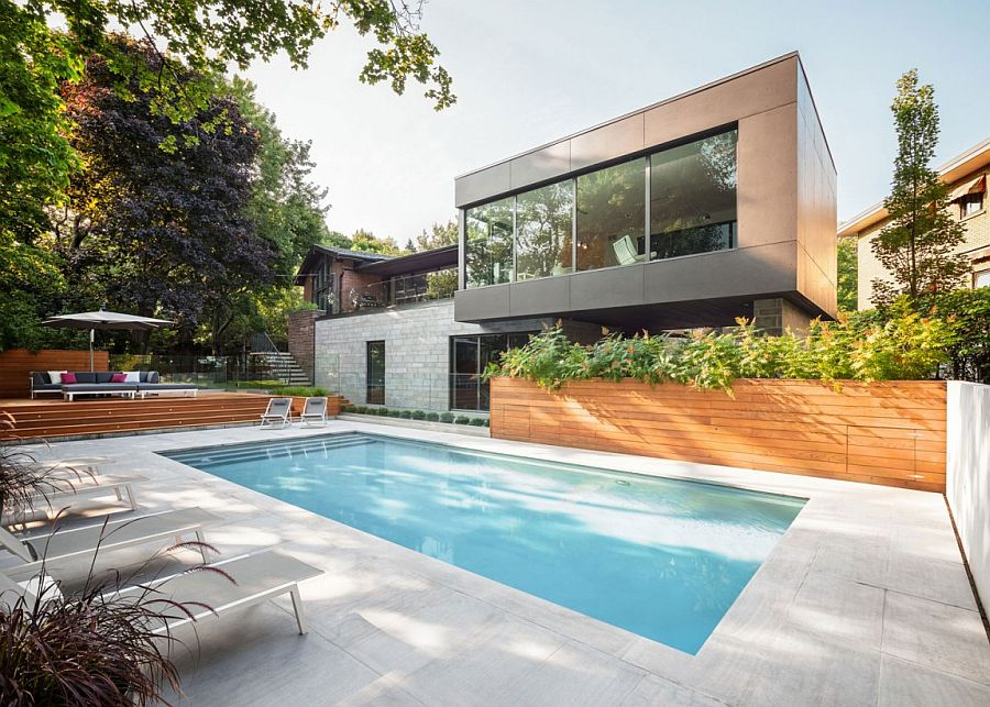 Anthracite colored concrete extension of the lovely Montreal residence Single Story Residence in Montreal Gets a Cantilevered Modern Extension