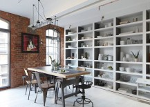 Arched metal windows and brick walls usher in the industrial charm