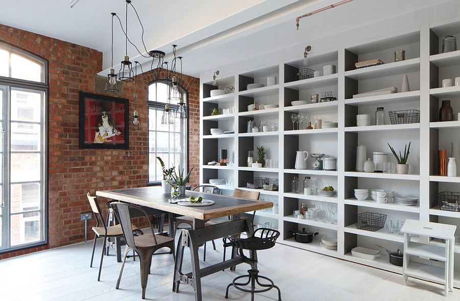 Arched metal windows and brick walls usher in the industrial charm [Design: Oliver Burns]
