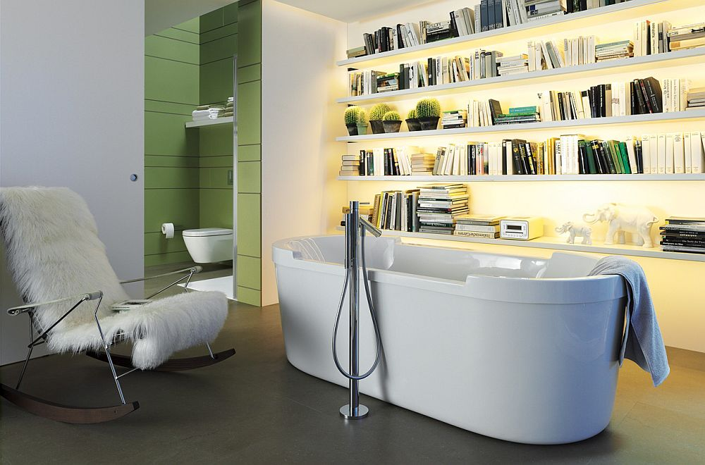 Bathroom with standalone tub and a sleek bookshelf [Design: Duravit]