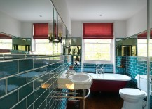 Bathroom with teal tiles and a bathtub in red!