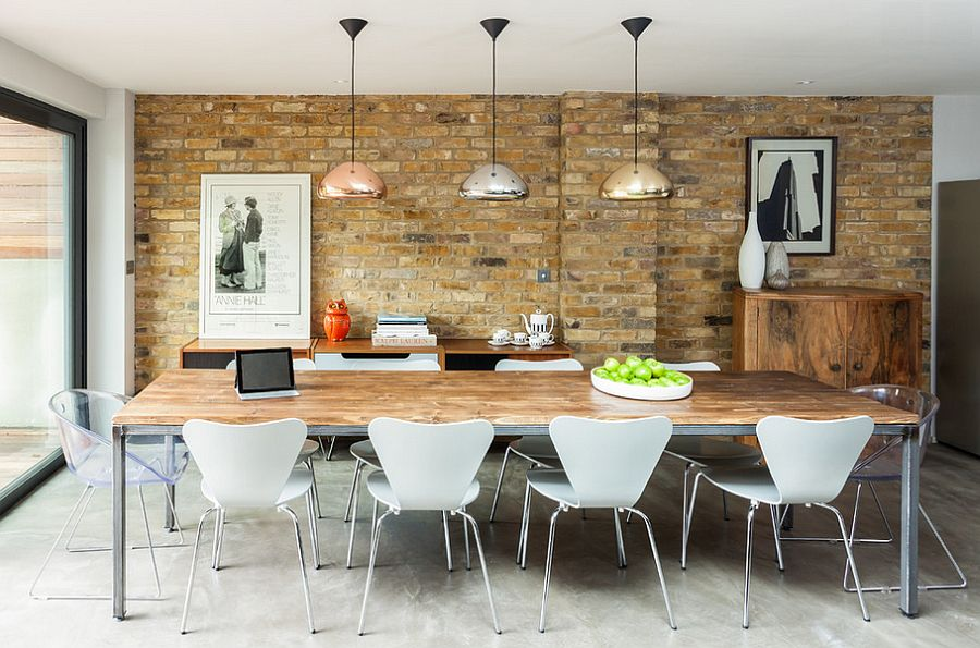beautiful dining room has a playful modern vibe design casey industrial lighting d