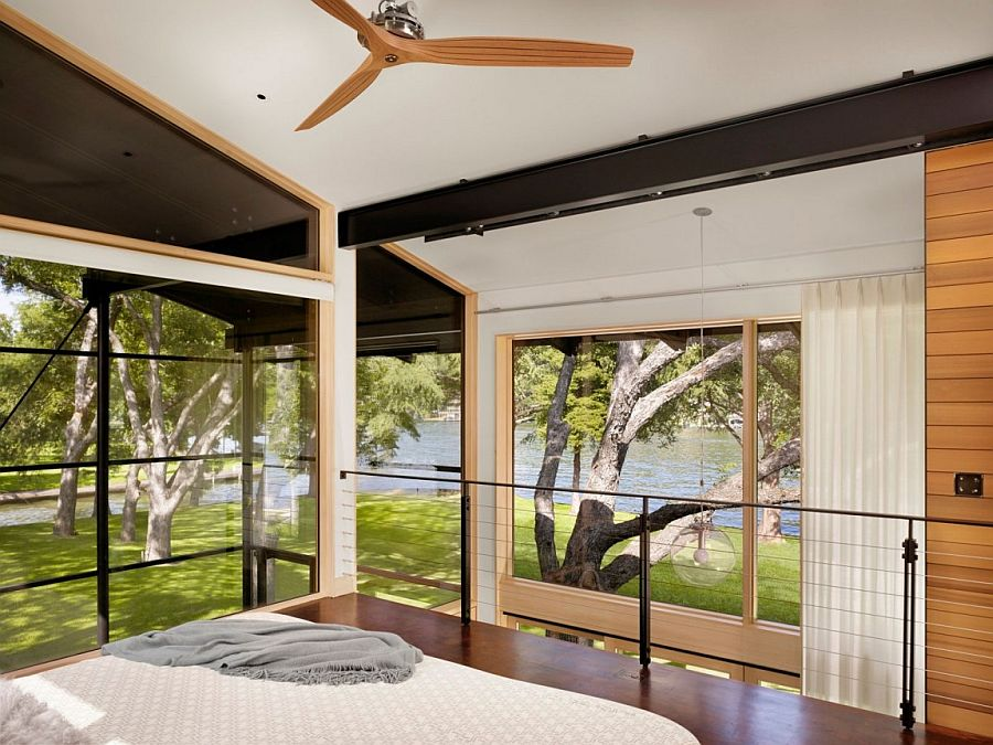 Bedroom with lovely lake views has an open, airy vibe