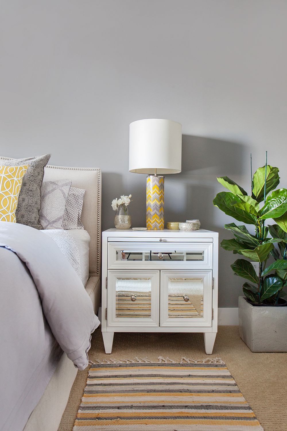 Bedside table lamp with yellow and gray chevron pattern