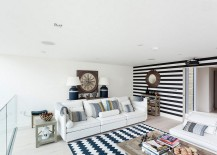 Black and white striped accent wall works with a wide range of styles